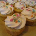 Coconut Cupcakes with Pineapple Filling
